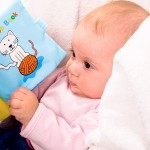 Baby looking at a book