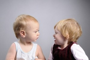 """Two toddler """"talking"""" to each other"""