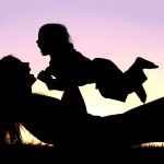 Mother playing aeroplanes with baby