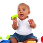 baby boy surrounded by toys