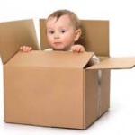 baby peeping out of a box.jpg