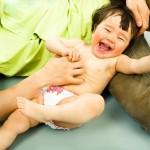 mum tickling baby